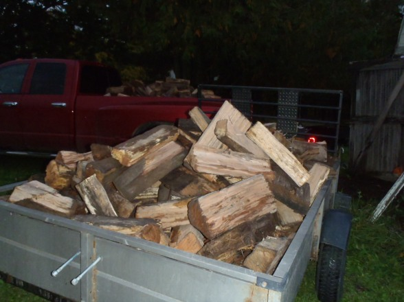 A pony trailer loaded with chooped up bridge mats for use as firewood.